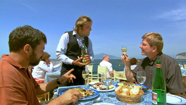 Rick Steves (right) and crew enjoy lunch on Italy&#39;s Amalfi Coast.
