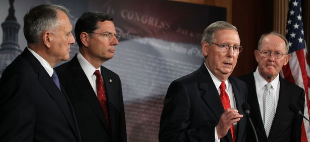 U.S. Senate Minority Leader Sen. Mitch McConnell (R-KY) (3rd L) speaks as (L-R) Senate Minority Whip Sen. Jon Kyl (R-AZ), Sen. John Barrasso (R-WY), and Sen. Lamar Alexander (R-TN) listen during a news conference July 12, 2011 on Capitol Hill in Washington, DC.