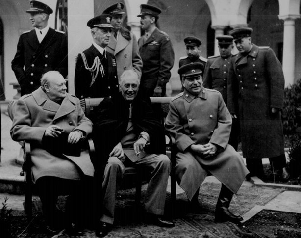 Conference of the Big Three at Yalta makes final plans for the defeat of Germany: Prime Minister Winston S. Churchill, President Franklin D. Roosevelt, and Premier Josef Stalin, February 1945.
