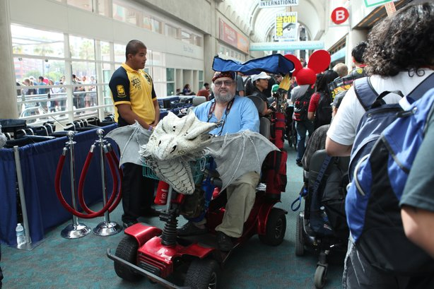 The Comic-Con regular with a dragon head on his wheelchair.