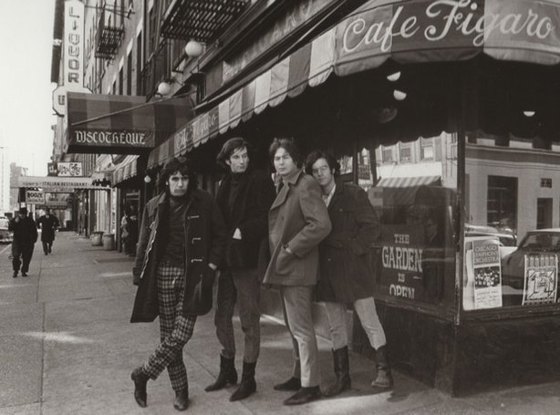 Promotional photo of The Lovin&#39; Spoonful standing in front of Cafe Figaro, a Greenwich Village coffeehouse. The Lovin&#39; Spoonful perform Do You Believe in Magic in &quot;Legends Of Folk: The Village Scene.&quot;