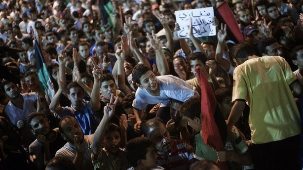 Tens of thousands of Libyans celebrate the partial fall of Tripoli in the hands of the Libyan rebels on August 21, 2011 in Benghazi, Libya.