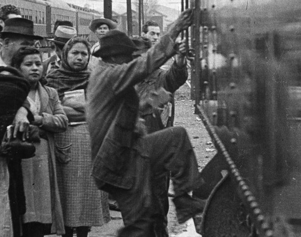 Historical photo of a Mexican man boarding a train to look for temporary work in the United States as part of the Bracero Program.