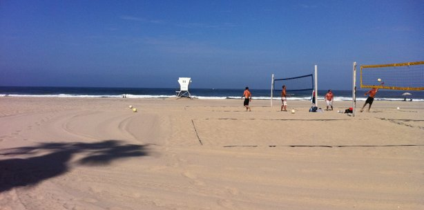 A few volleyball players are about the only people at Mission Beach after a second shark sighting in two days prompts lifeguards to keep swimmers out of the water.