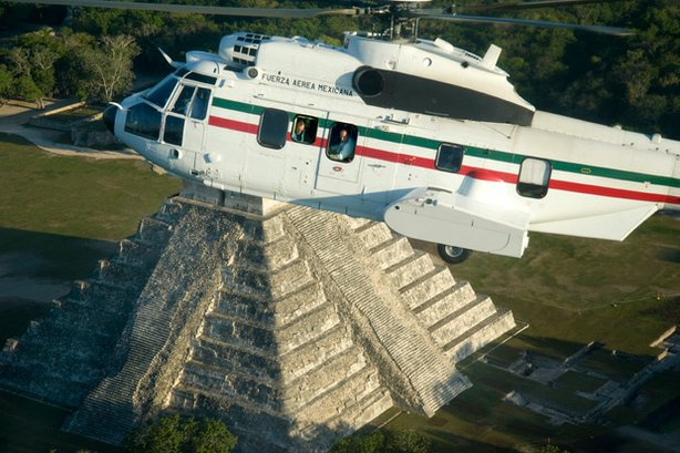 "Peter Greenberg and President Felipe Calderon in his helicopter over Mexico during the filming of ""Mexico: The Royal Tour."""