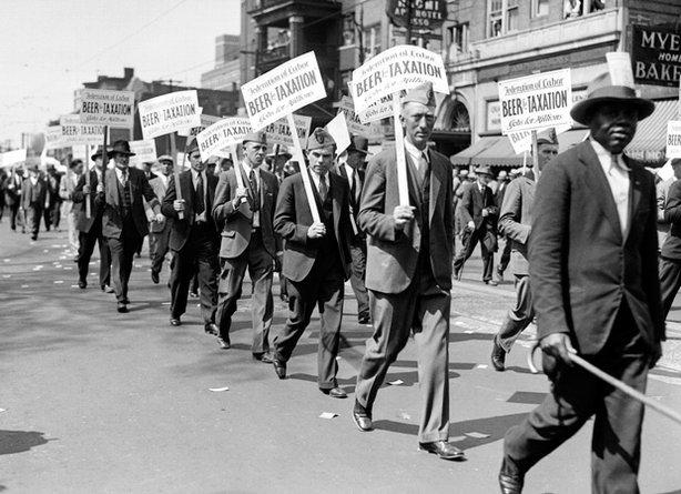 "The Great Depression struck the final blow against Prohibition. Here, marchers in Detroit bear signs reading, ""Beer for Taxation, Jobs for Millions"" ca. 1930."