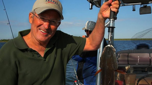 In Port Aransas, Texas, Joseph Rosendo tries his hand at fishing.