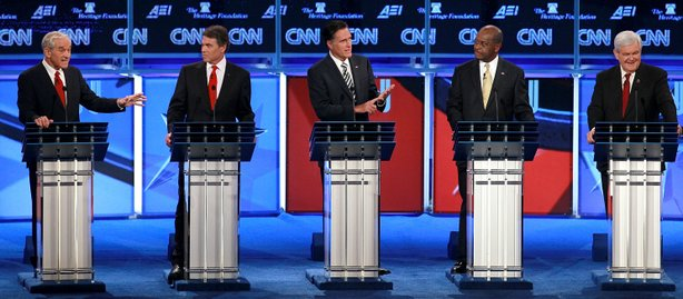 Republican presidential candidates (L-R) U.S. Rep. Ron Paul (R-TX), Texas Gov. Rick Perry, former Massachusetts Gov. Mitt Romney, former CEO of Godfather's Pizza Herman Cain and former Speaker of the House Newt Gingrich participate in a debate at Constitution Hall November 22, 2011 in Washington, DC.