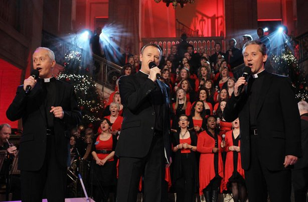 "Father Eugene O'Hagan, Father David Delargy and Father Martin O'Hagan from the classical music group known as the Priests perform on stage in ""Christmas Carols With The Priests."""