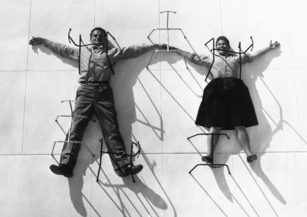 "Charles and Ray Eames ""pinned"" by chair bases, 1947."