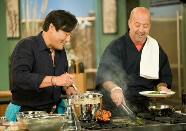 Host Ming Tsai cooking with guest chef Andrew Zimmern in season nine of &quot;Simply Ming.&quot;