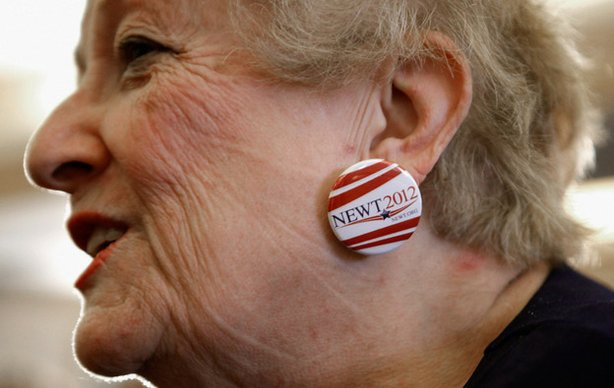 Judy Youngblood of Jacksonville, Fla., appears at a rally at the Hyatt Regency Jacksonville Riverfront hotel Monday, wearing earrings she made from campaign buttons supporting Newt Gingrich.