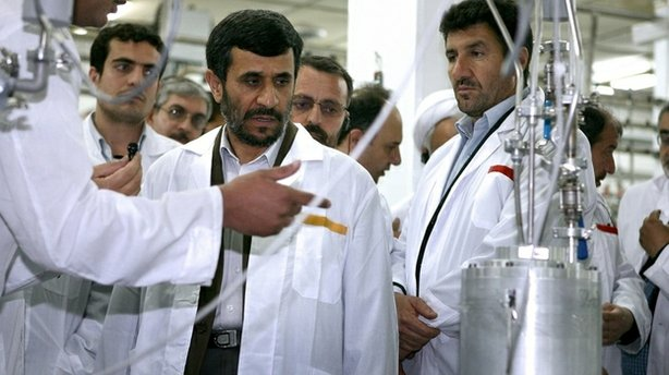 Despite international pressure, Iran has pressed ahead with its nuclear program. Here, Iranian President Mahmoud Ahmadinejad listens to a technician during a visit to the Natanz Uranium Enrichment Facility, 200 miles south of the capital, Tehran, in 2008.