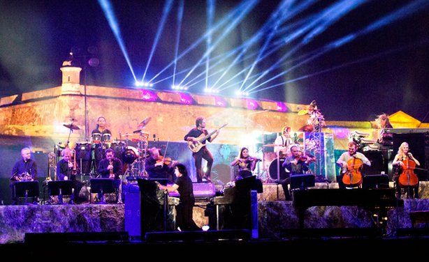 Yanni, backed by his orchestra, performs at the historic 16th-century Castillo San Felipe del Morro in San Juan, Puerto Rico, December 2011.