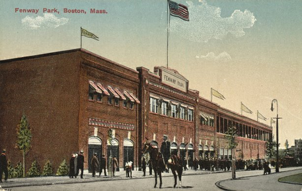 A policeman on horseback stands outside Fenway Park; colored photograph.