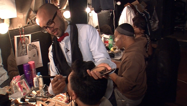 "Anthony Diaz helps actor Shaun Tuazon with his make up backstage at Tenth Avenue Theatre for ""Deconstruction of a Drag Queen."""