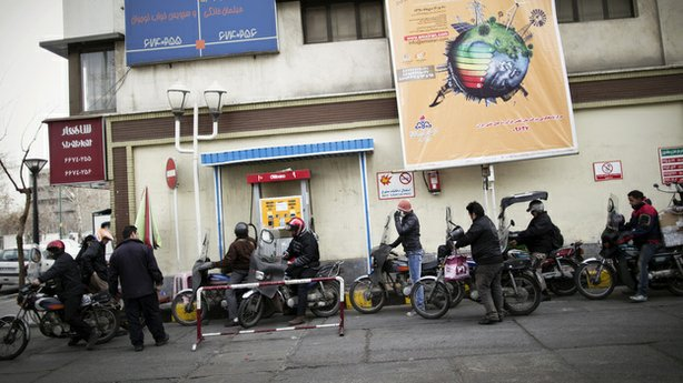 Iranians line up at a petrol station to fuel their motorcycles in central Tehran, Feb. 19. Oil is the lifeblood of Iran's economy, but the planned E.U. boycott is expected to deal a major blow to Iranian oil exports.