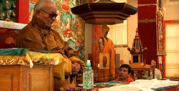 Chgyal Namkhai Norbu teaches while his son, Yeshi, looks on as Rinpoche gives teachings to thousands of local Kalmyks.