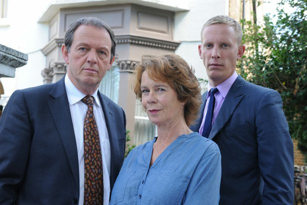 "Kevin Whately as Inspector Lewis, Celia Imrie as Michelle Marber, and Laurence Fox as DS Hathaway in ""The Soul Of Genius."""