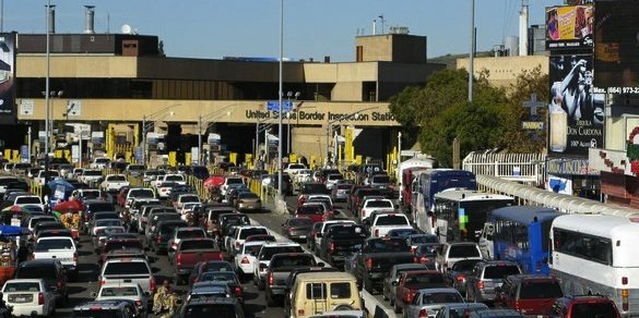 Cars wait in line at the San Ysidro border crossing.