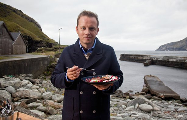 Host Andreas Viestad eats a brightly colored salad with smoked haddock while visiting the wind-blown peninsula of Stad in Western Norway.