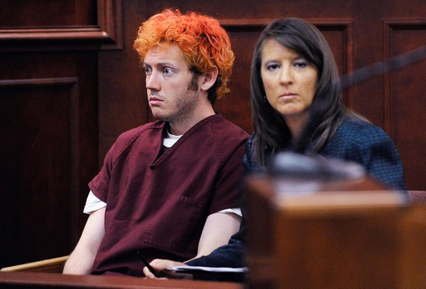 Accused movie theater shooter James Holmes (L) makes his first court appearance at the Arapahoe County Courthouse with his public defender Tamara Brady on July 23, 2012 in Centennial, Colorado. 
