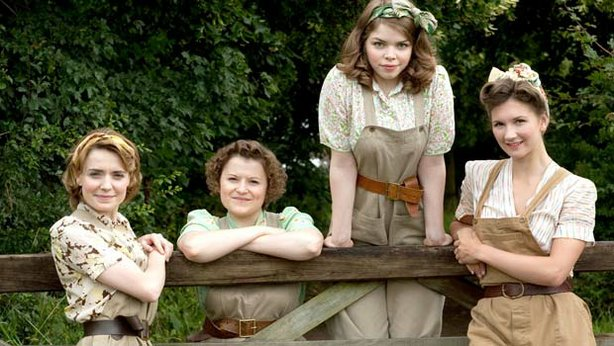 Annie Barratt played by Christine Bottomley; Joyce Fisher played by Becci Gemmell; Bea Holloway played by Jo Woodcock; Nancy Morrell played by Summer Strallen from the television series LAND GIRLS.