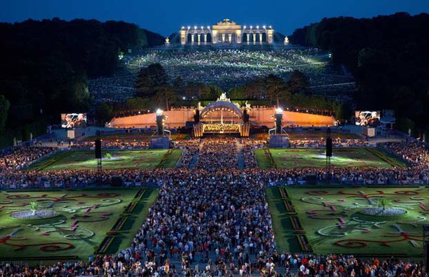 The Vienna Philharmonic Orchestra performs under the stars in the magnificent gardens of Austria's Imperial Schönbrunn Palace, June 7, 2012.