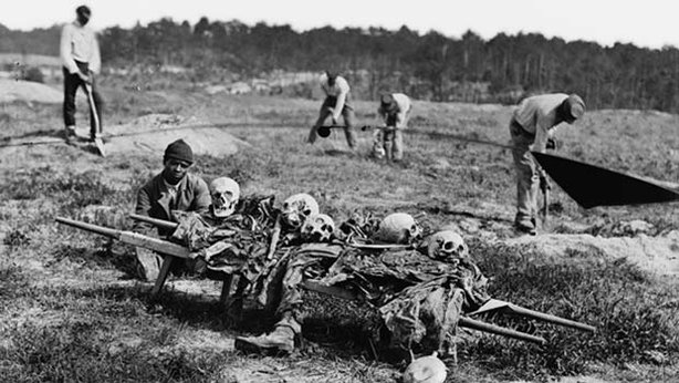 African Americans collecting bones of soldiers killed in the battle of Cold Harbor in Virginia one year earlier, April 1865.