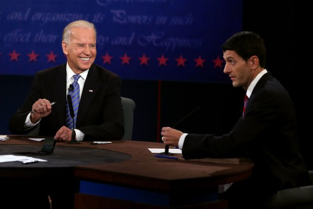 U.S. Vice President Joe Biden (L) listens as Republican vice presidential candidate U.S. Rep. Paul Ryan (R-WI) speaks in the vice presidential debate at Centre College October 11, 2012 in Danville, Kentucky.