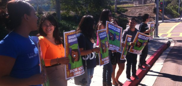 Supporters of the DREAM Act, which would give many young undocumented immigrants a path to citizenship, protest outside Congressman Brian Bilbray's Solana Beach office.