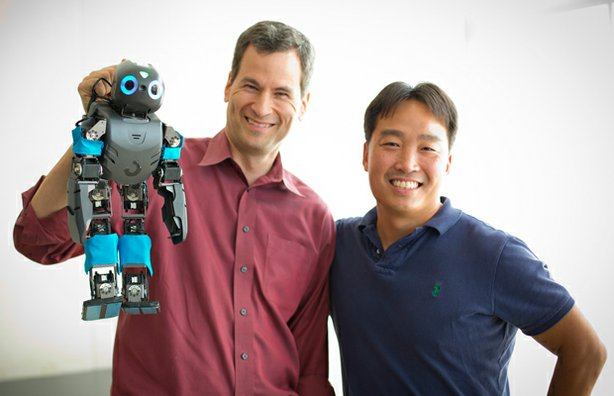 David Pogue and Dan Lee (UPenn) pose with DARwin OP. Dan and his students at GRASP lab design software that helps robots navigate.