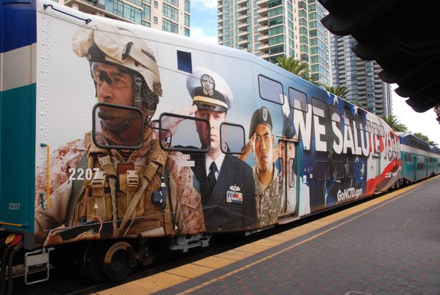 A Coaster train car with a special wrap to honor military members and veterans.