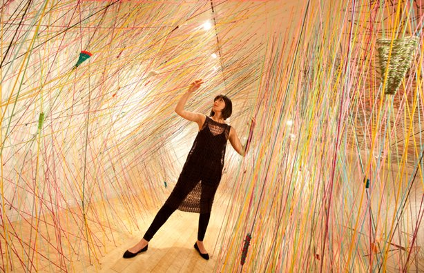 Tanya Aguiiga in her 2011 installation at the Craft and Folk Art Museum, &quot;Crossing the Line.&quot;