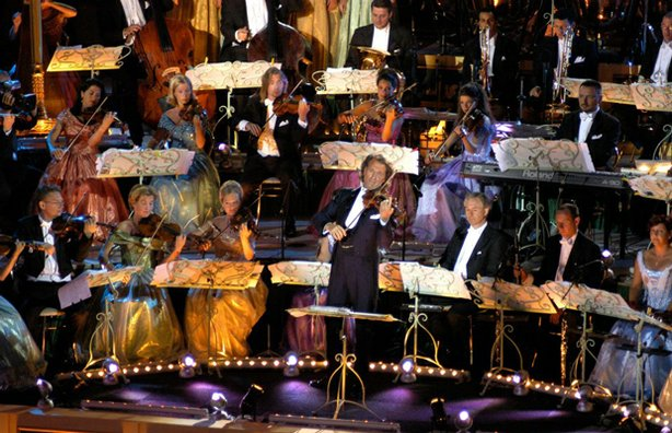 Andr Rieu (center playing violin) performs live in Tuscany, Italy at the Piazza Della Republica joined by the Johann Strauss Orchestra.