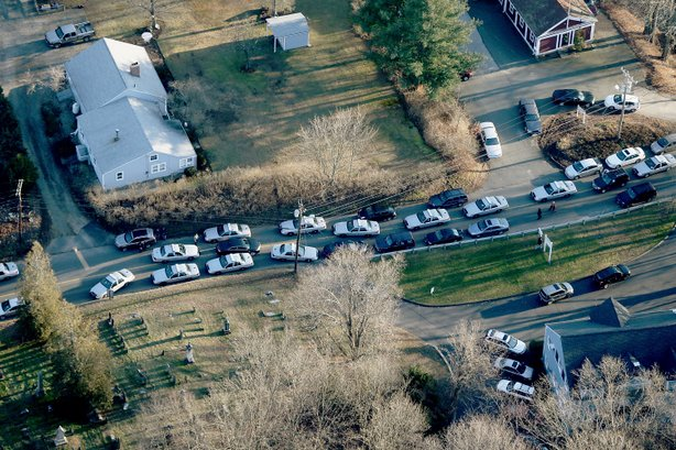 Police cars and other vehicles fill a road near the scene of a mass school shooting at Sandy Hook Elementary School on December 14, 2012 in Newtown, Connecticut.