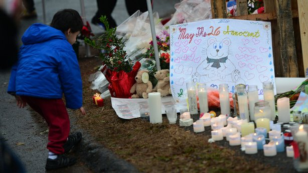 A makeshift shrine honors the victims of a elementary school shooting that happened Friday in Newtown, Conn.