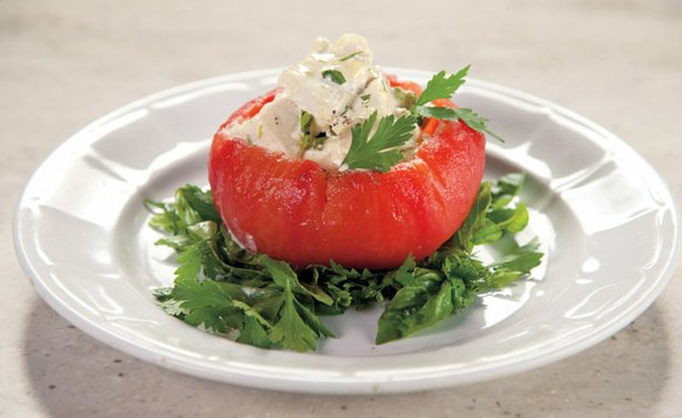 Chicken salad stuffed tomato. Martha shows how one of the most healthful and versatile preparations — simply poached chicken breast — can be incorporated into all-American chicken salad sandwiches as well as a Cobb salad.