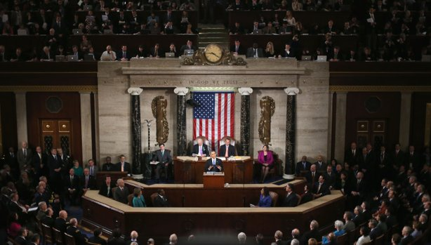 Flanked by U.S. Vice President Joe Biden (L) and Speaker of the House John Boehner (R), U.S. President Barack Obama (C) delivers his State of the Union speech before a joint session of Congress at the U.S. Capitol February 12, 2013 in Washington, DC.