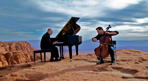 YouTube sensation ThePianoGuys, featuring Steven Sharp Nelson on cello and Jon Schmidt on piano, perform at a stunning outdoor venue in Salt Lake City, Utah.