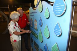 Visitors looking at a water conservation exhibit at the Reuben H. Fleet Science Center on Senior Monday.