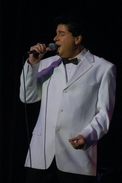 Image of performer Mark Curran singing. He will be featured at the Frank Sinatra tribute performance at the California Center for the Arts: Escondido on October 17.