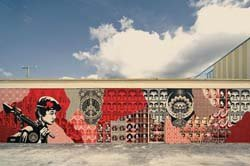 Shepard Fairey&#39;s Street Mural Miami, a stencil and mixed media collage. Photo taken by Photo by Geoff Hargadon, Courtesy of OBEY GIANT ART.