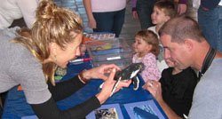 Image of a family participating in the learning adventure of SEA Days at Birch Aquarium. SEA Days offers ocean discovery for all ages.