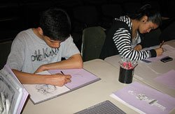 Teens drawing at a table during the Teen Art Café at the San Diego Museum of Art.