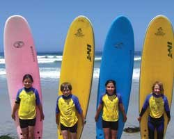 Promotional photo of young surfers having fun at Birch Aquarium At Scripps&#39; Summer Learning Adventure Camp. 