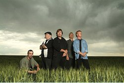 Promotional photo of the band Firefall: Wheat Field Before the Storm, Windsor, CO. 2004. L to R: Chris Ball, Sandy Ficca, Jock Bartley, Bil Hopkins and Steve Weinmeister. Photo Credit: Steve Collector