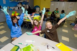 Guests enjoying science camp at the Reuben H. Fleet Science Center.