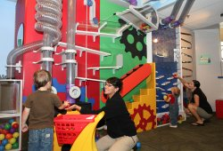 "Promotional photo of guests enjoying the ""Kid City"" exhibition. Courtesy of the Reuben H. Fleet Science Center"