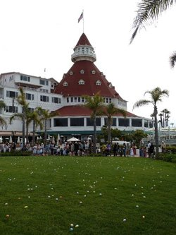 Promotional image of the Hotel Del Coronado&#39;s Windsor Lawn filled with Easter eggs. 